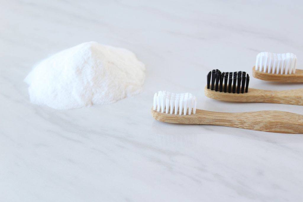 Baking soda with bamboo toothbrushes