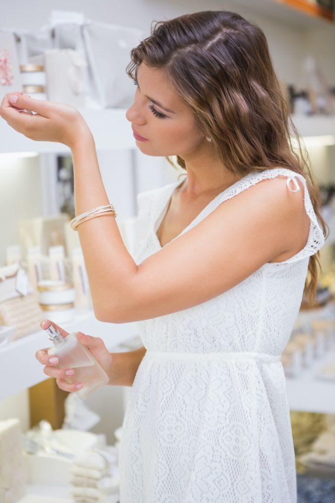 Woman testing perfume at a beauty salon