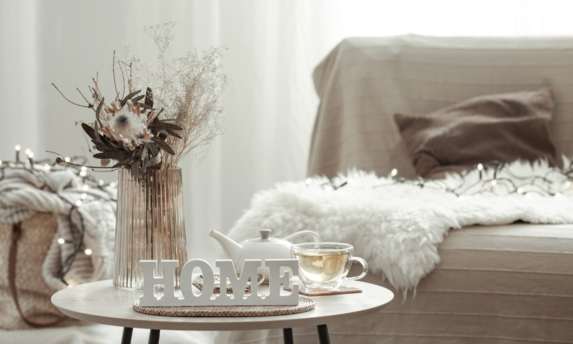 Home composition with decorative word home, tea and decor details.