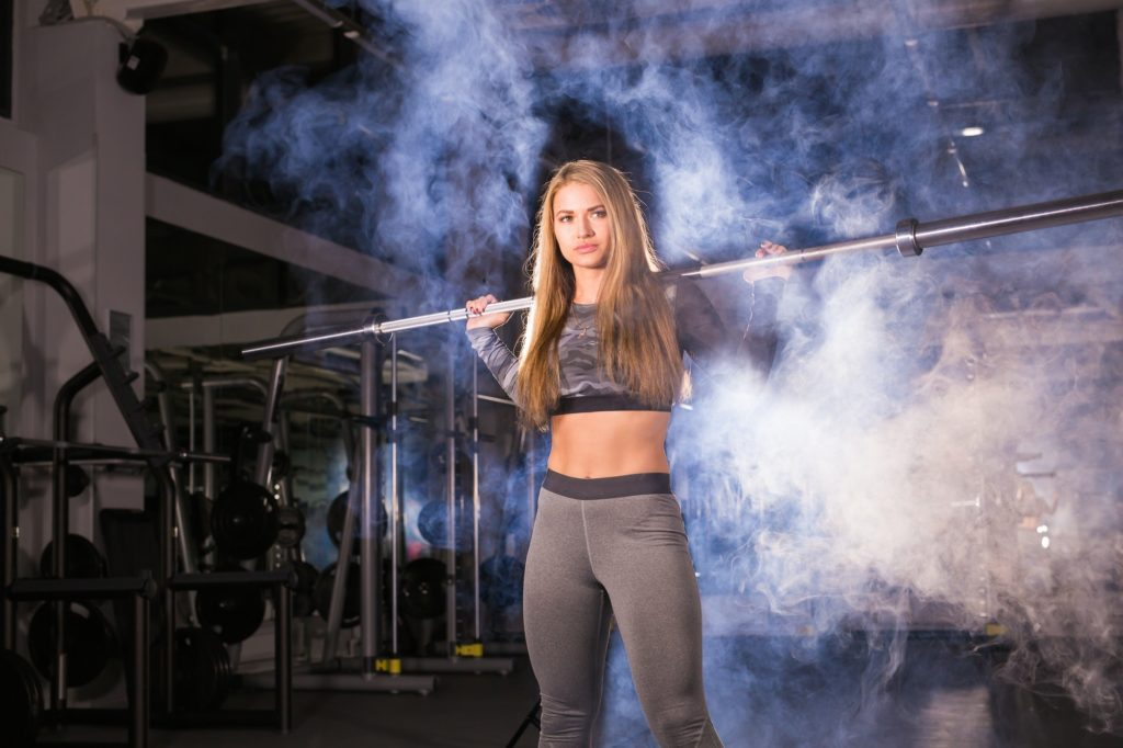 Close up of female fitness exercise weight training cute pretty building strength and confidence
