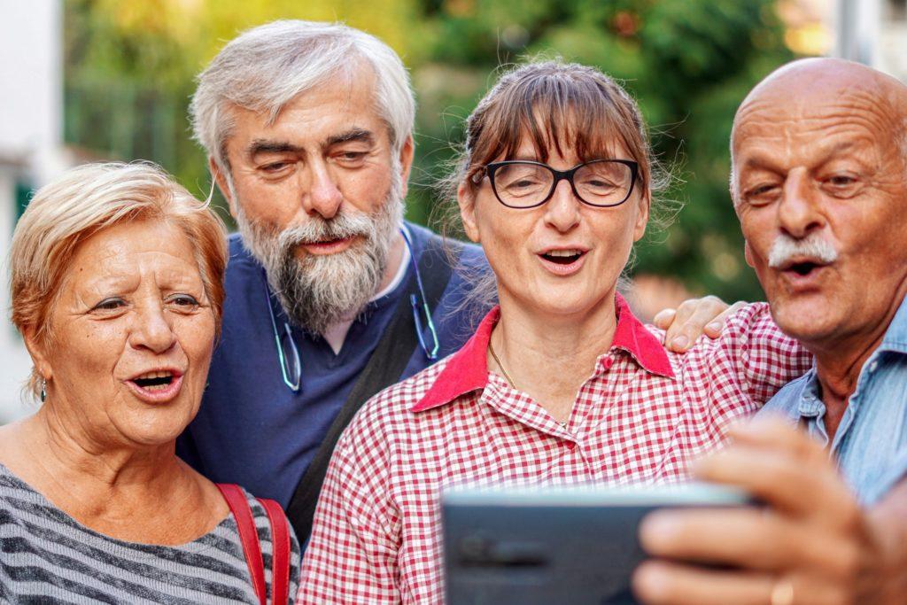 Elderly couples taking selfie with smartphone