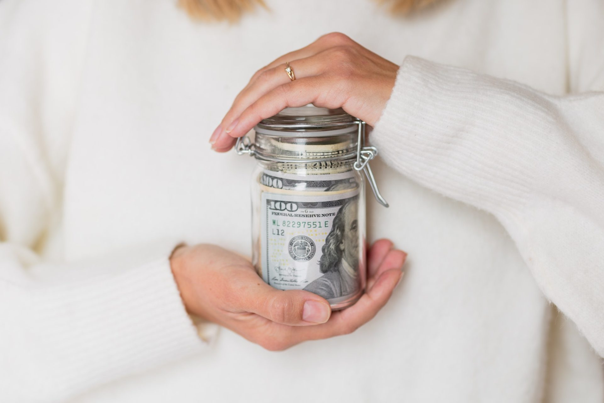 Woman Holding Hands Glass Bank With Cash Money